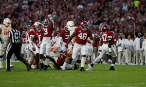 Alabama defensive players celebrate a fourth down stop versus Tennessee
