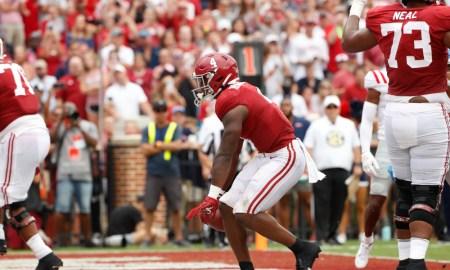 Brian Robinson Jr. (#4) celebrates rushing TD for Alabama versus Ole Miss