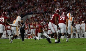 Bryce Young (#9) running with the ball for Alabama versus Tennessee