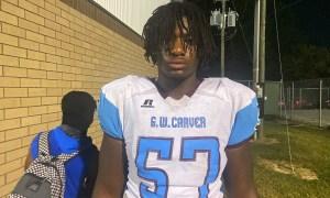 Elijah Pritchett poses for pciture after Carver game