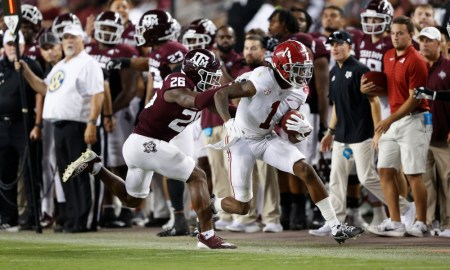 Jameson Williams (#1) runs with the ball down the sideline for Alabama versus Texas A&M
