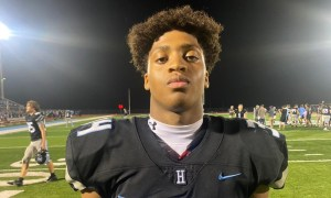 Jordan Washington poses for picture after Helena game