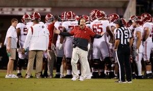 Nick Saban talking to an official on the sideline versus Miss. State