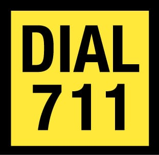 """Yellow box with thick black border. Inside box text reads """"Dial 711"""""""