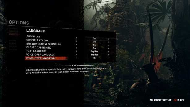 Video game interface. Language options are shown for subtitles, color, captioning, voice-over immersion is selected. Image is dark, but a jungle can be seen in background.
