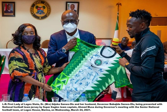 Lagos state governor receiving Super Eagles jersey
