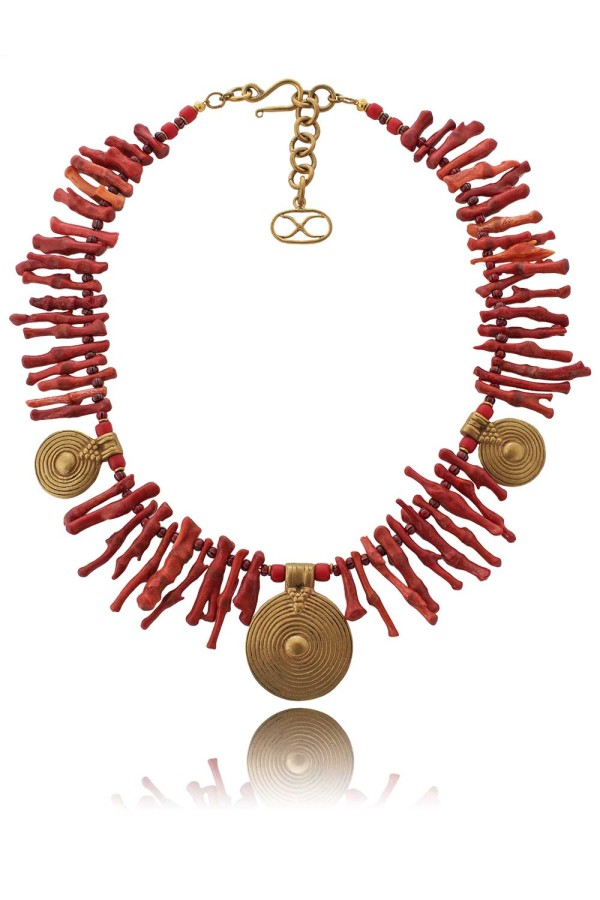 "Medusa Necklace - Stunning red coral branches offset by ""full moon"" brass pendants from Mali are the captivating features of this statement creation. In mythology, coral was regarded to provide protection, particularly from evil influences. This stems from the story that when Perseus beheaded Medusa, some of her blood dripped into the sea and became stunning red Coral. [Image: Courtesy of Shikhazuri]"
