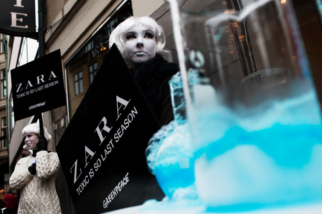 Greenpeace activists join a global day of action, protesting outside a Zara clothing store in Copenhagen to demand the clothing chain Detox their clothing lines. [Image: Copyright.  Greenpeace / Benita Marcussen]