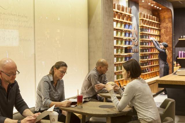 Charles Cain, left, heads Concept Development for Teavana's new stores.