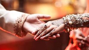 Bride-groom-hands-holding-couple-1