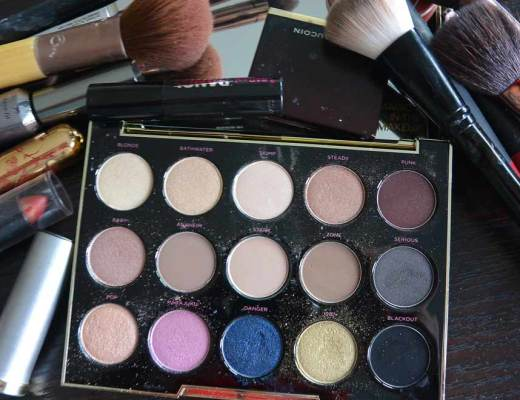 Makeup brushes, eyeshadow pallette, lipsticks, and other cosmetics