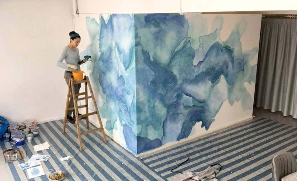 Bridget mural painting. Up a ladder. Mural in process.