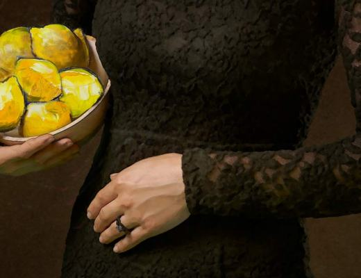woman's torso, wearing black lace, holding bowl of lemons
