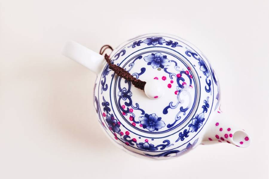 Coronavirus Tea Teapot, viewed from above, a blue & white china teapot with pink dots of Covid-19