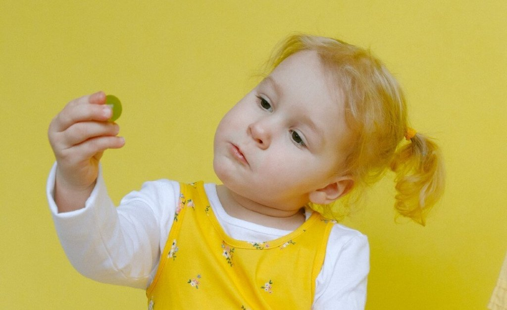 """Little girl looking at a grape, worries """"I'm fat"""""""