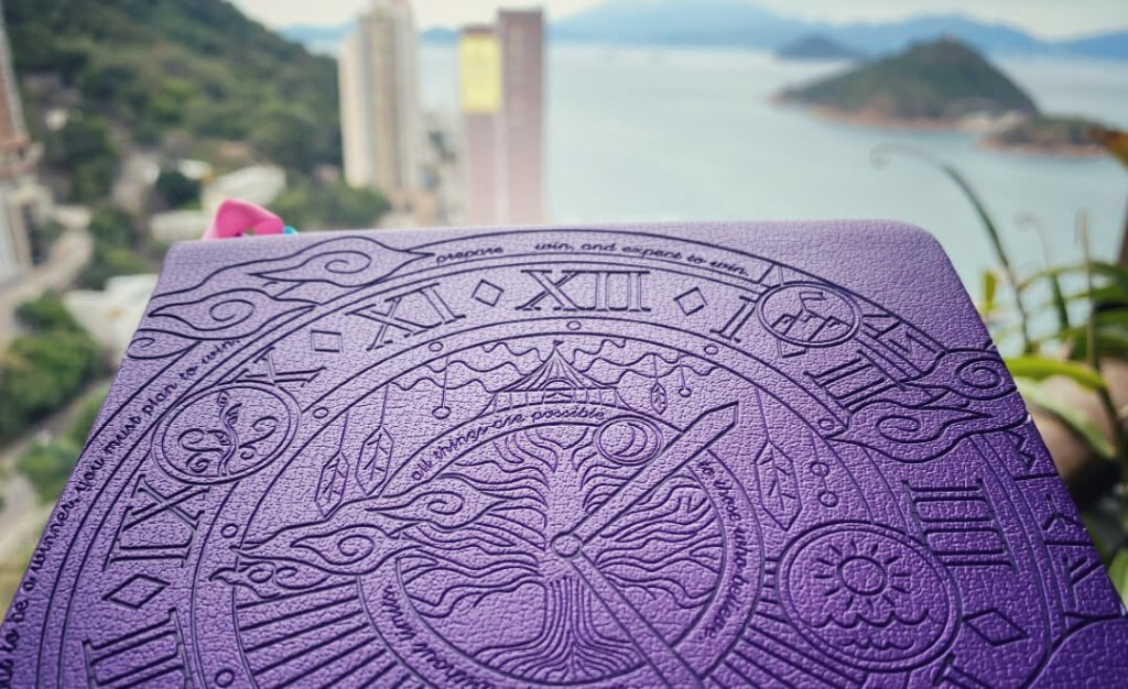 Legend planner close up with Hong Kong in the background