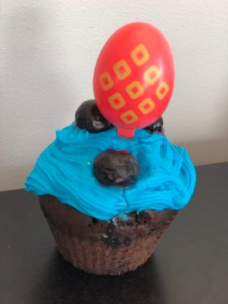 Gluten free cupcake (chocolate with blue icing) for celiac disease