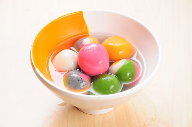 Tangyuan meaning family togetherness: The pronunciation and round shape of Tangyuan are associated with reunion and being together. That's why they are favoured Chinese during New Year celebrations.