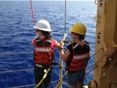 Two scientists connect the umbilical and the winch line to ensure our ROV is stable.