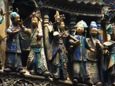 small figurines on top of the temple
