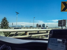 Armando Torres driving in Mexico with the iztaccihuatl volcano in the background