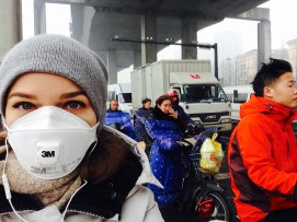 Daria Bokova from Russia living China, cycling through the polluted streets