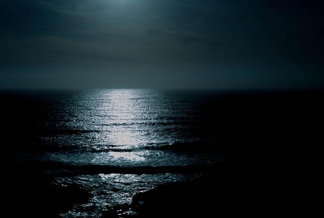 a moon over the ocean