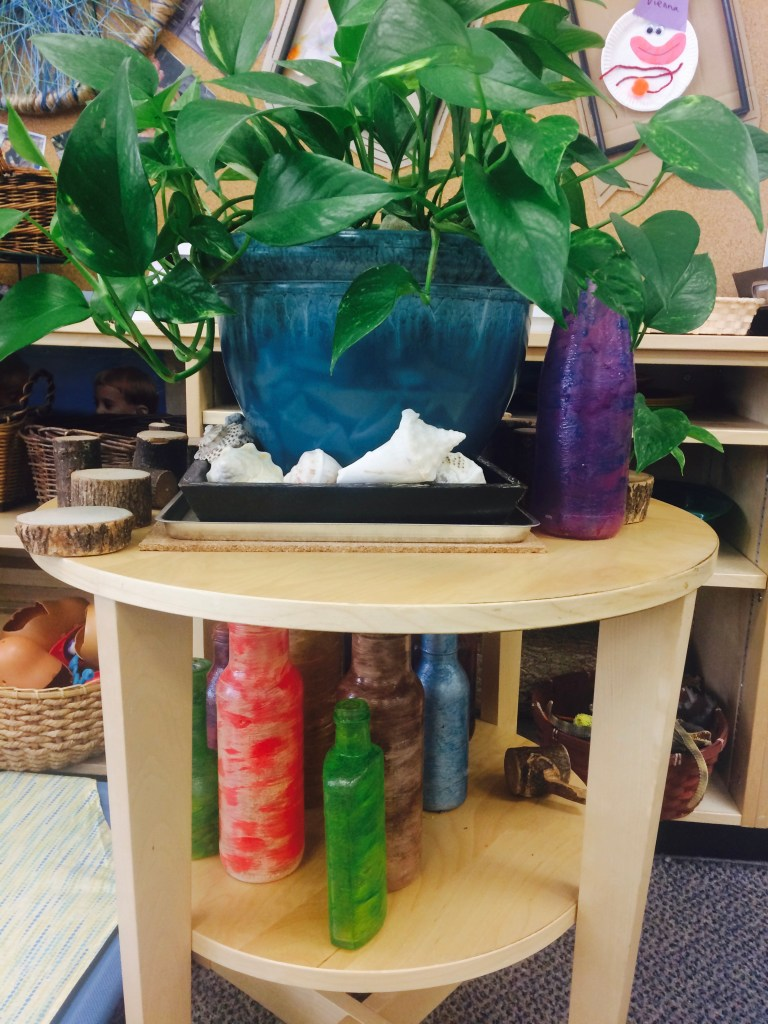 Their collection of glass bottles and plants help to make the learning space interesting and calm!