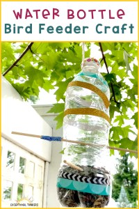 "Water bottle decorated with colorful washi tape and toothpicks with text that reads ""water bottle bird feeder"" in teal and purple font"