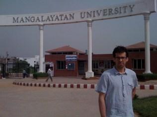 Nathan Loewen standing in front of Mangalayatan University, Aligarh, U.P.