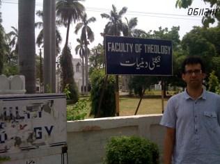 Nathan Loewen standing in front of Aligarh Muslim University