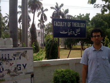Nathan Loewen standing in front of Aligarh Muslim University