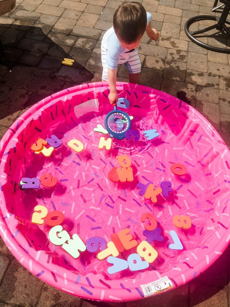 Try this simple toddler outside activity to keep your child busy and learning on a hot summer day. They will learn letters & work on hand-eye coordination.