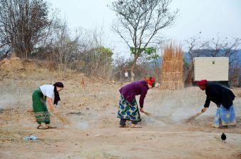 Susannah, Kim, and Mabuchi sweeping in the morning