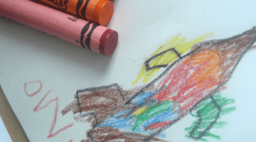 owen's got grip using large crayons to help support tripod grip.png
