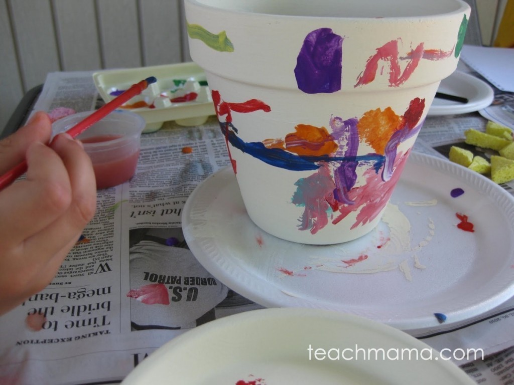little hand painting on white pot
