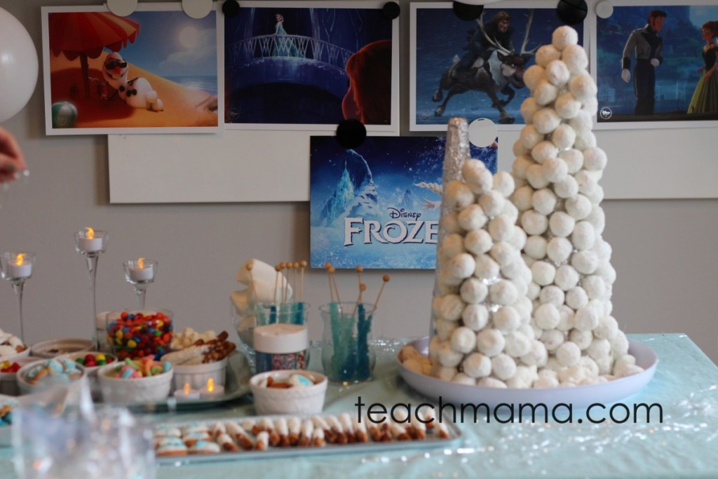 frozen birthday party tower and snacks on table