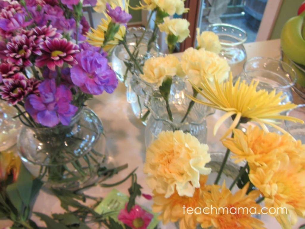 various flowers in vases on counter