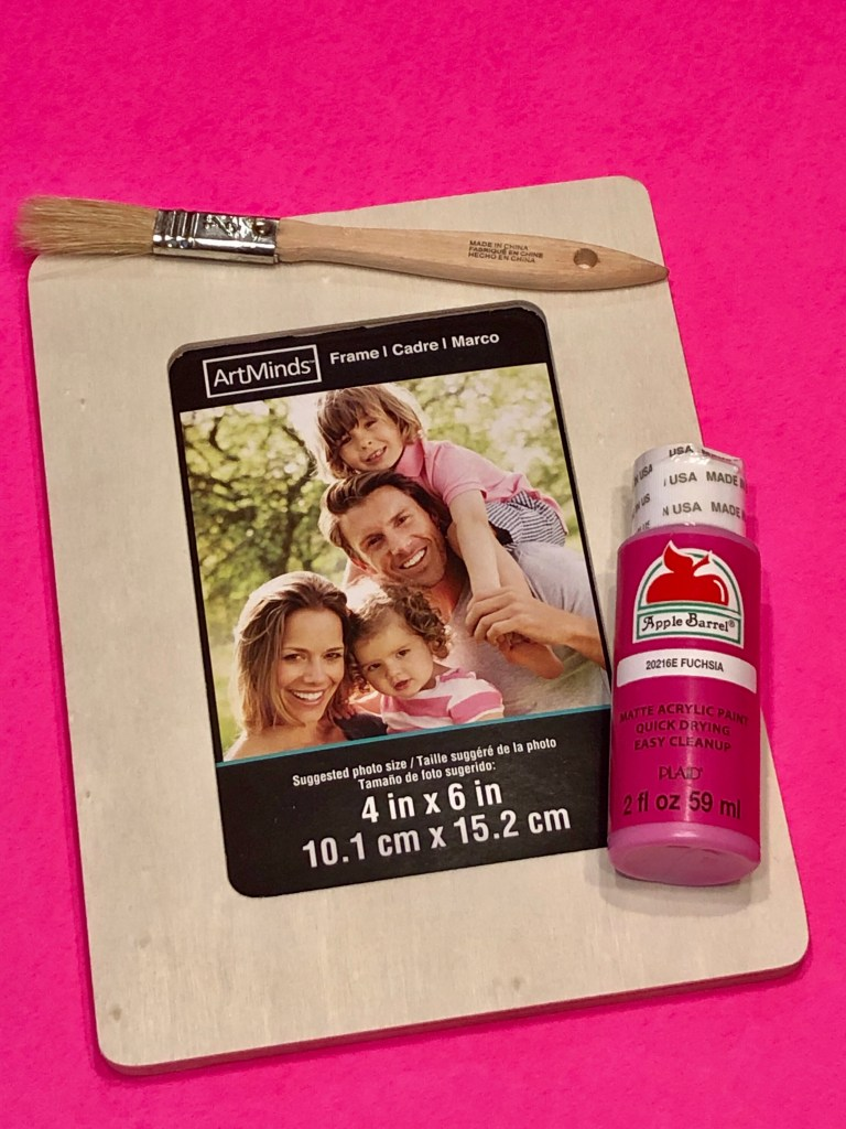 "A photograph of a 4"" x 6"" wooden frame, paintbrush, and small bottle of acrylic paint in fuchsia.  These are the items needed to create a sweet Mother's Day gift from kids."