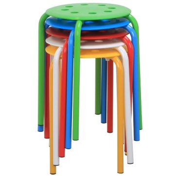 An image of 5 stools-green, blue, red, white, and yellow- that are stacked on top of each other.