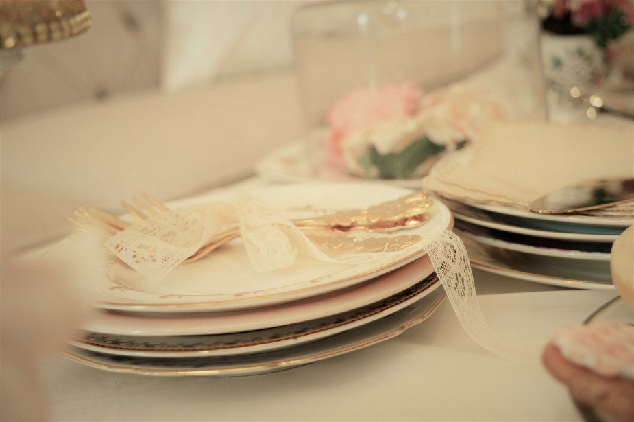 Vintage plates and gold flatware for cake