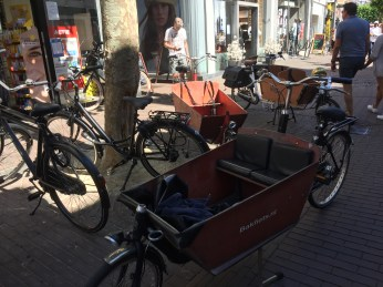 How have we not mentioned much about bikes? They were absolutely everywhere in Belgium and The Netherlands! This wooden cart, which we think had to be meant for cargo, far more often carried several children.