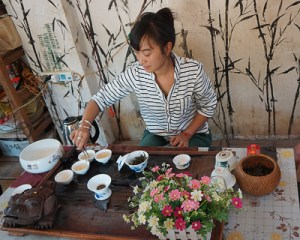 A young Akha tea master