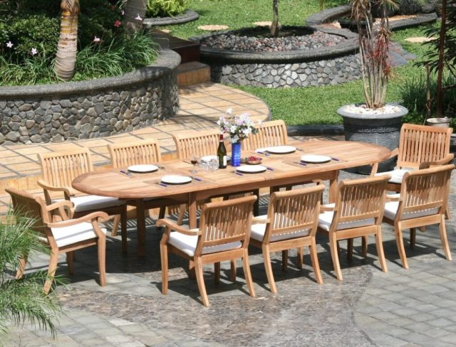 11 piece grade-a teak dining set - large oval table and stacking arm