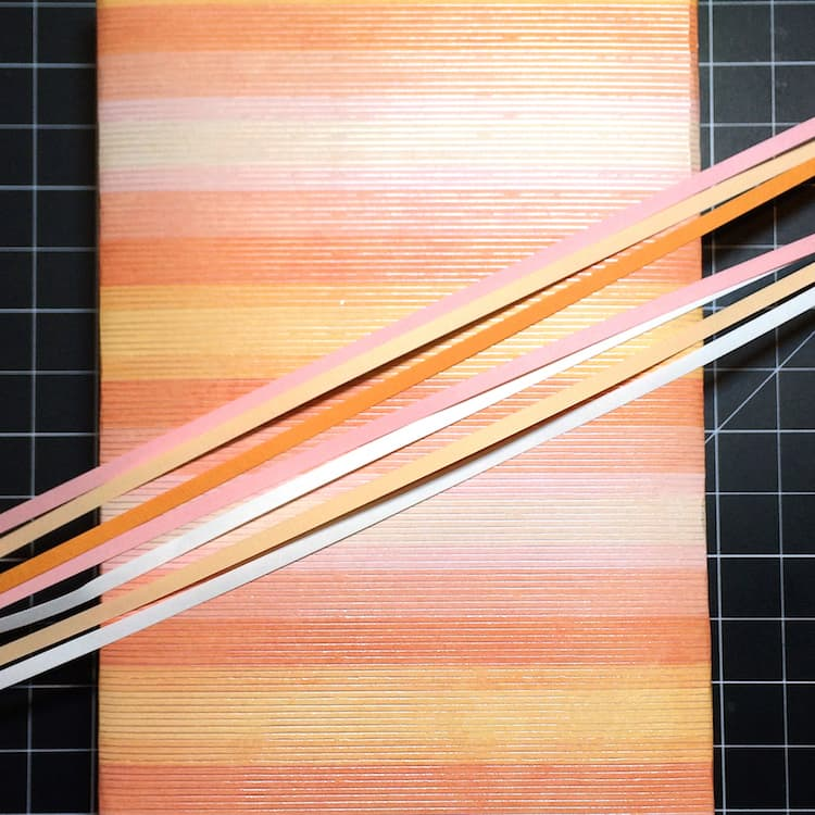 How to make a paper tassel with quilling paper strips. Use them on your gift wrapping, cards, and scrapbooks!