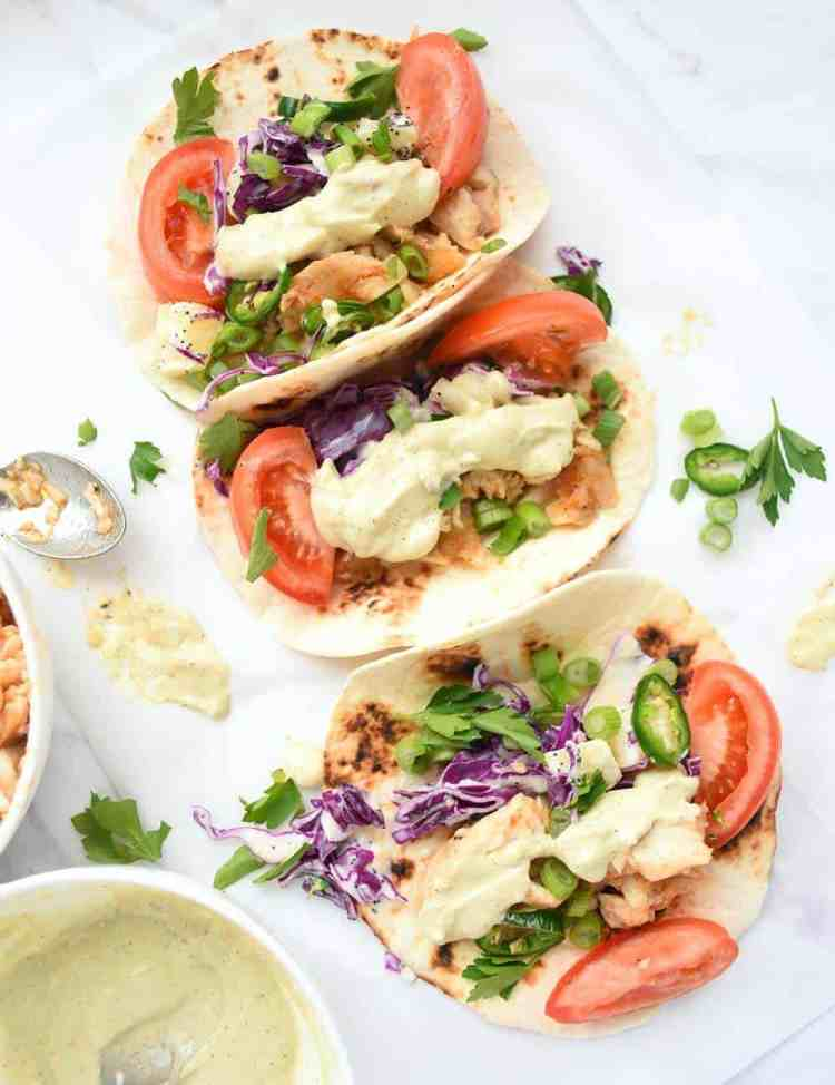 Spicy Fish tacos that are healthy and ready in about 20 minutes, the best fish taco recipe with pineapple slaw