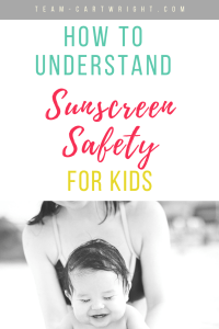picture of a mom holding a happy bay splashing in a pool. Text overlay How To Understand Sunscreen Safety For Kids