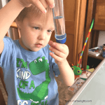 picture of a preschooler looking at a test tube