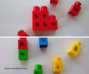 Practicing letters with blocks.