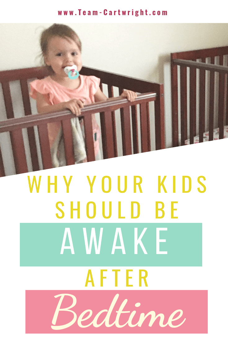 picture of a toddler standing up in a crib with text overlay Why Your Kids Should Be Awake After Bedtime